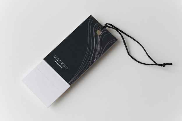 black and white mockup tag on white surface